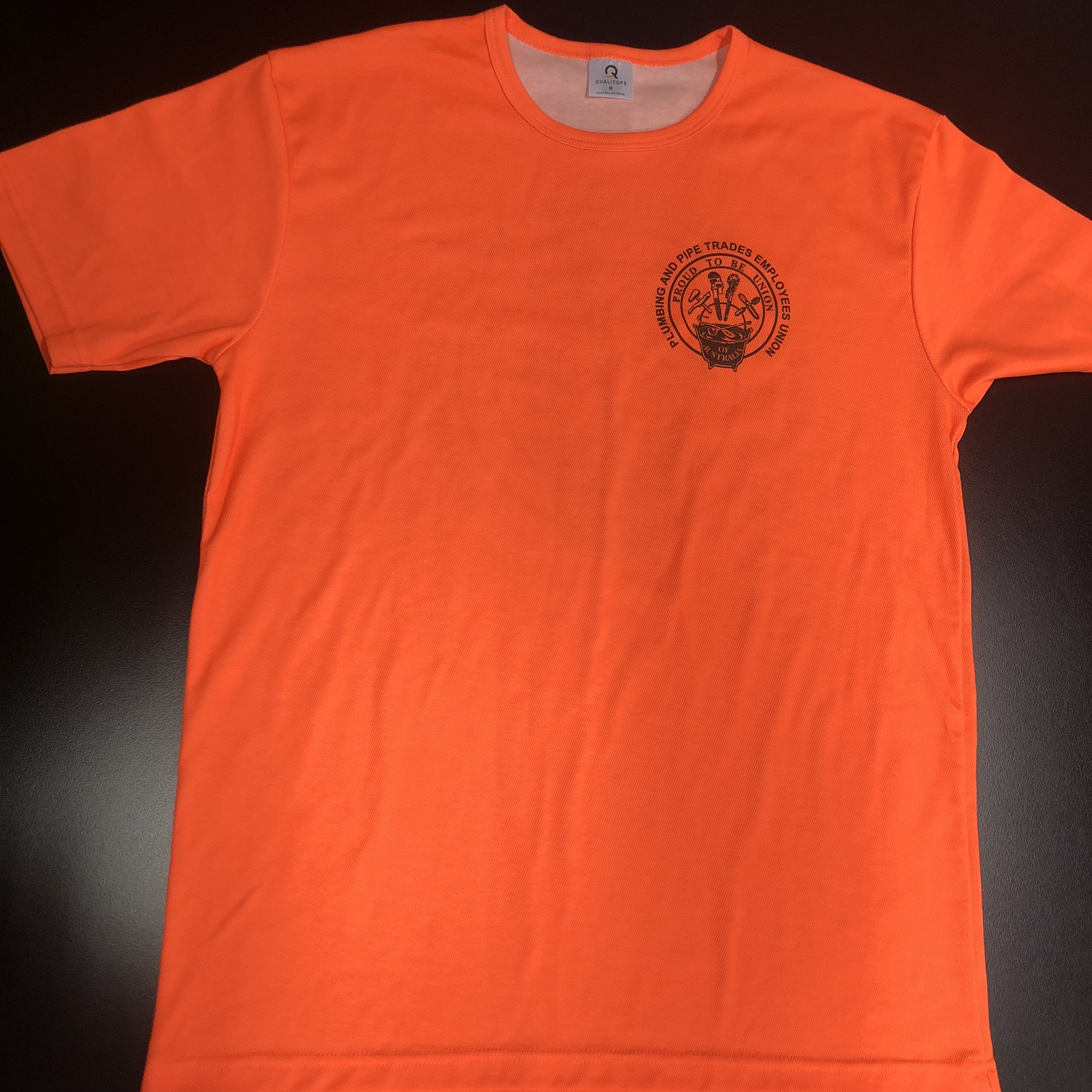 merch orange front.jpeg